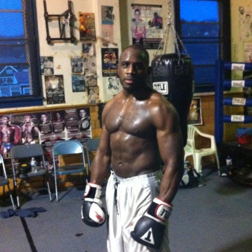 Ed Latimore in the gym with black gloves and white trunks